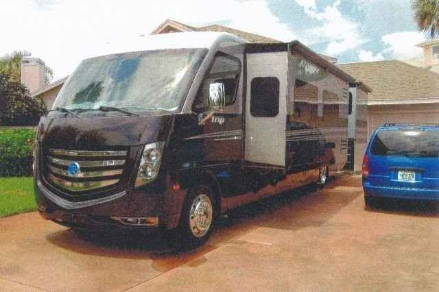 2012 Used Holiday Rambler Trip Class A in Florida FL.Recreational Vehicle, rv, Unit is new, never used, was moved from Tucson to Florida with travel miles (low), approx 4800 miles. This beautiful RV unit has two slide outs and is painted in a rich silver and onyx black with piano bar interiors color scheme. Unit has large queen bed in master bedroom, combo washer-dryer unit in bedroom closed, large walk up in mirrored closet, many storage drawers in bedroom plus storage under the bed…