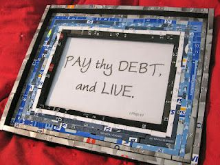 """Cut up credit cards were used to decorate this picture frame containing a new favorite quote - """"Pay thy debt, and live!"""""""