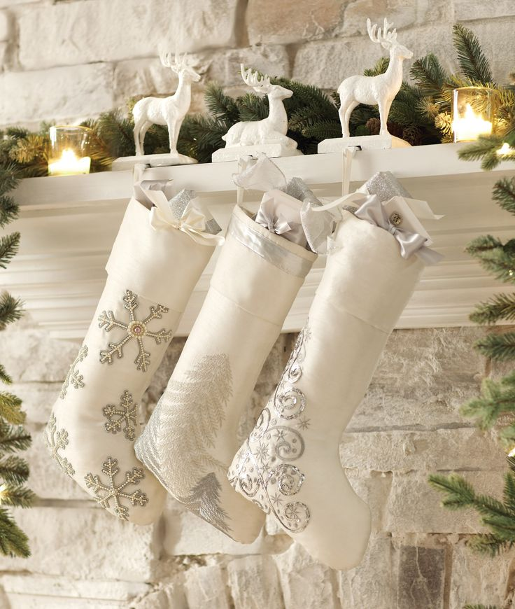 Mantels look better with stockings. HomeDecorators.com #holidays #holiday2014