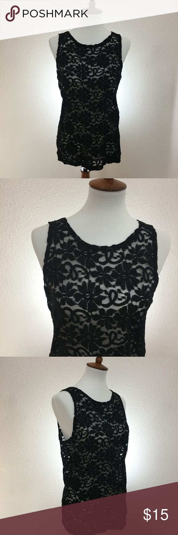 Solange Girls Black Lace Tank Top Solange girls lace tank top  Size: 14/16 Style: Lace tank top Color: Black Material: 100% Nylon Condition: Lightly worn, tag is worn but other than that its in excellent used condition with plenty of useful life left  Measurements Bust (Armpit to Armpit): 18in Sleeve Length: 2in Length – Back (Top to Bottom): 23.5in   From a smoke and pet free home, offers welcome. HAPPY POSHING!!!  Item #: A54P083 Solange Shirts & Tops Tank Tops