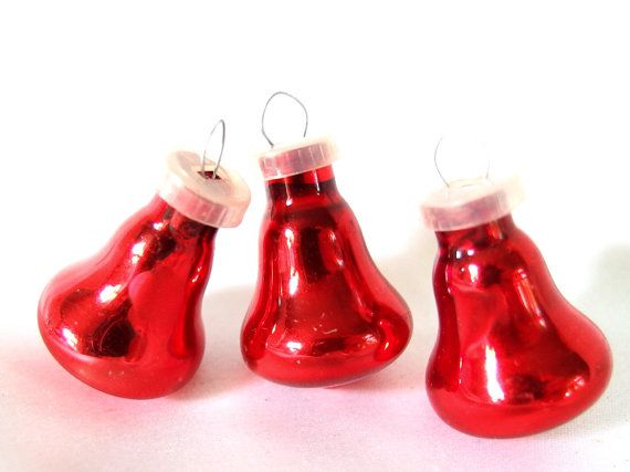 Vintage Christmas ornaments are small, red bell ornaments for a feather tree. They have plastic caps.  They are 1.25 inches (3.2 cm) tall, not including hanging loop.  Condition: Very good - vintage patina, minor scrapes.  Check here for more red ornaments: http://www.etsy.com/shop/bythewaysidexmas?section_id=15786757  Thanks for looking! I am happy to answer questions! Jaci BythewaysideXmas.etsy.com  Indiana sales tax added to purchases by Indiana residents.  I ship WORLDWIDE!  These…