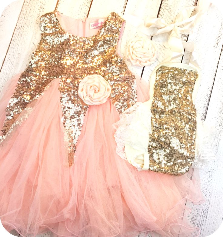 This set is gorgeous with the gold sequins and ruffle lace detail. Perfect matching sister outfits for those special occasions. Dress comes adorned with a soft cream peach rosette flower and matching barrette.  Just adorable!!!