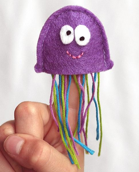 Felt Ocean Finger Puppets- Put it on a stick instead of using it as a puppet, just close up the bottom. Use longer pieces of yarn and mix it up with a little ribbon too.