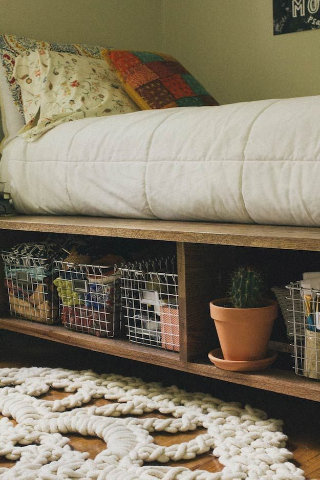 Platform Bed with Storage and Baskets | Creative Pieces Of Wood For A New Bedroom With A Storage by DIY Ready at   http://diyready.com/14-diy-platform-beds/