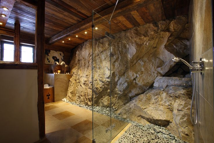 Massive stone shower in luxury val d is re chalet rustic for Beau jardin bath rocks