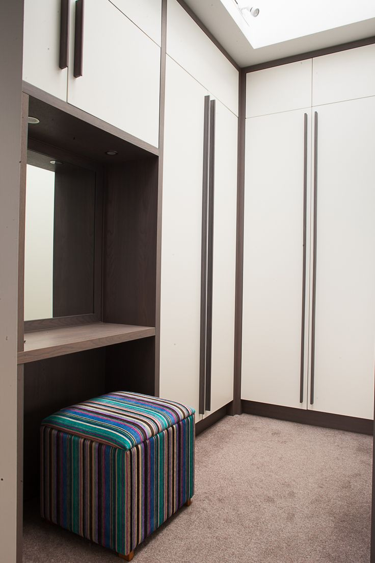 Contemporary dressing room. Grey stained oak handles and dressing table