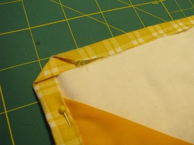 """""""cheater"""" quilt binding- uses the backing folded over. Good pointers for corners."""