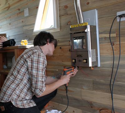 having a wood-burning stove in our tiny house would have been amazing, if we have planned for it correctly. Because we did not, we turned to another great tiny home heating option: the propane heating stoves made for boats by Dickinson Marine.