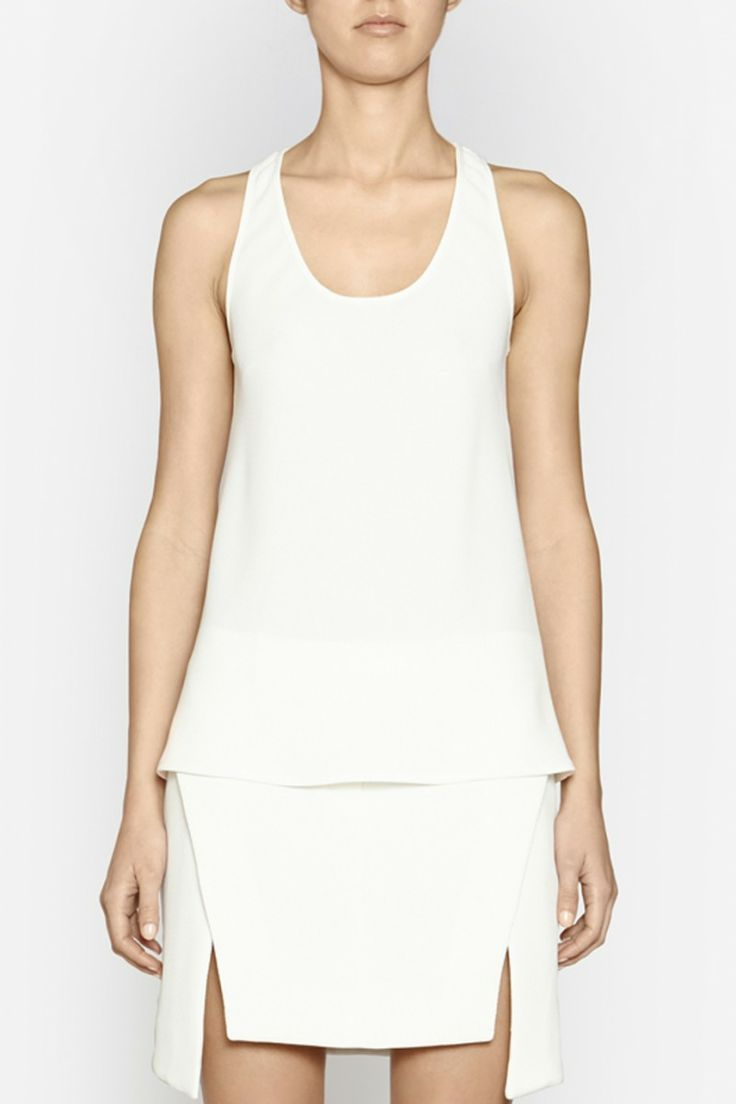 Camilla and Marc | REVOLUTIONARY TANK  US$201.01 Classic tank designed in a textured waffle fabric in white. This wardrobe staple features a scoop neckline and racerback design.