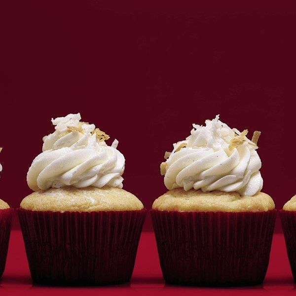 Vanilla Bean Coconut Cupcakes w/ Coconut Frosting. The secret to these moist cupcakes? Reduced coconut milk.