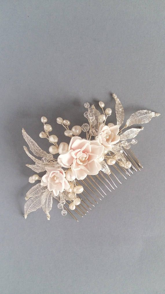 This beautiful handmade bridal hair comb made with freshwater pearls,blush handcrafted flowers, clear crystals and tiny silver leaves. Complement most wedding hairstyles. It is the perfect bridal headpiece for that woman who wants to simply sparkle on her wedding day. ♥ Size approx 14 сm x 8 сm (5,5 x 3 ) ♥ Available in silver plate and gold as well. Choose at the metal type box ♥ ATTACHES: secures easily with the attached large comb ♥ The bridal heapiece will be packed in a gift box ♥ Hand…