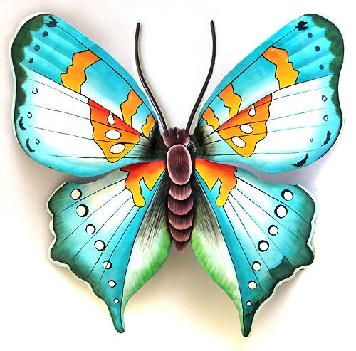 Beautifully hand painted aqua and gold butterfly wall hanging. Lovely for inside or outside of your home. Handcrafted in Haiti from recycled steel drums. www.TropicDecor.com