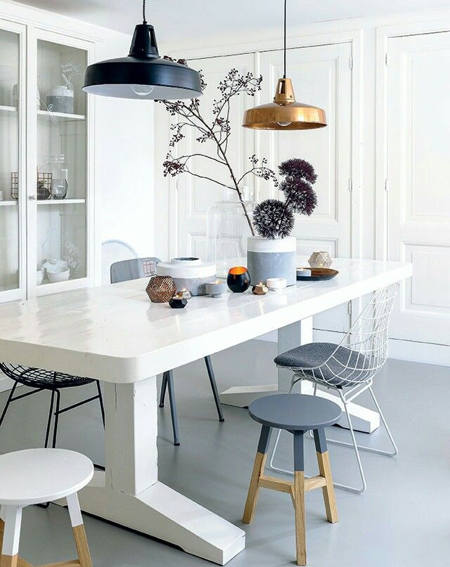 White, grey and brass dining room