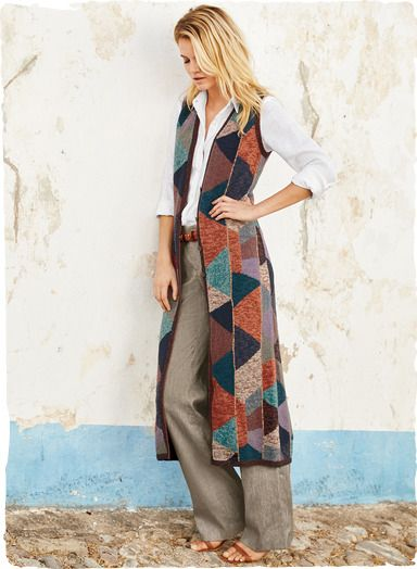 Columns of bold abstract triangles pattern Kaffe Fassett's stunning art knit vest. Gorgeously handframed in a tweeded palette of rich sun-baked colors—from chambray, turquoise and indigo to sage, adobe and rosy mauve. The dramatic, boot-length silhouette has a buttoning placket and handcrocheted edging.