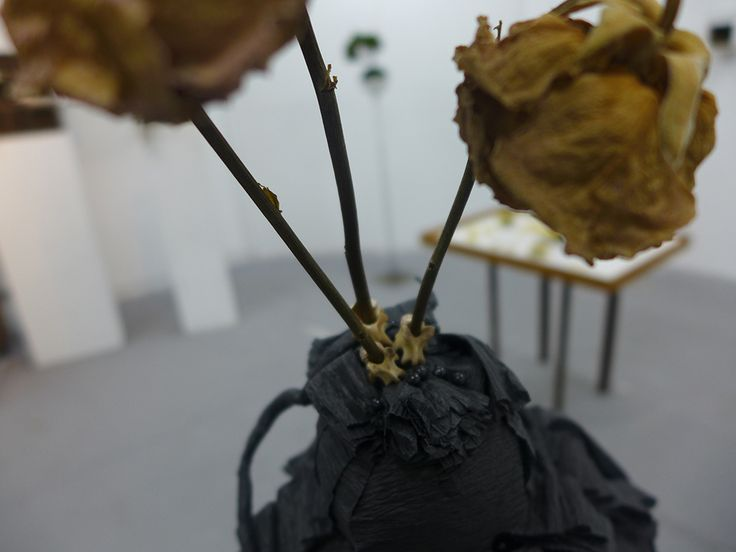 three sisters close up, animal bones, wire, pins, dried roses, crepe streamers.