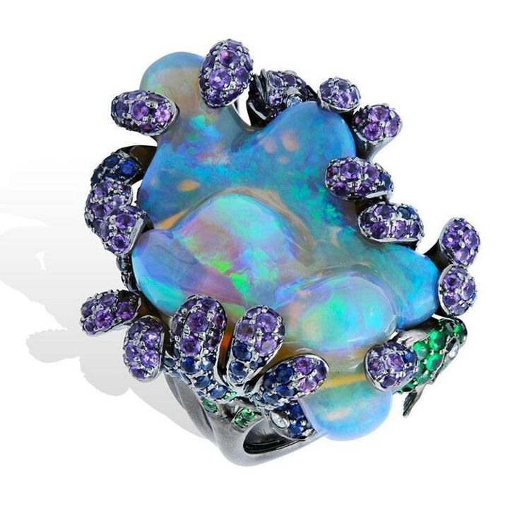 "From Lydia Courteille's Deep Sea Collection, inspired by the underwater world.  This polished baroque opal, still in its natural form with tendrils of ""seaweed"", set with purple amethysts and green tsavorites."