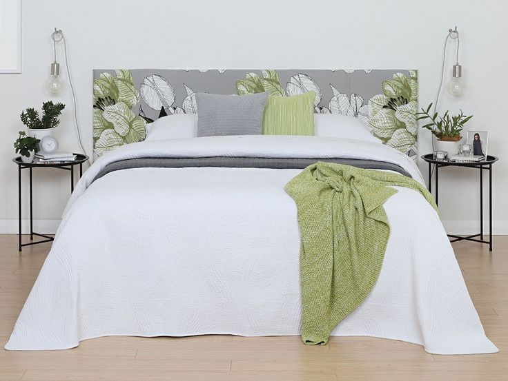 Costa White Bedspread - A luxurious white quilted bedspread with a subtle wave pattern and flanged edges.