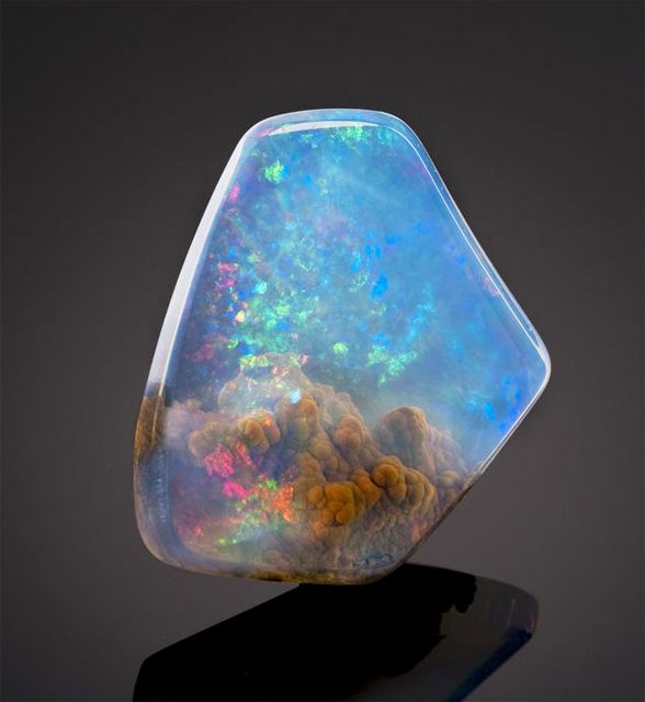 Things like this piece of Galaxy opal are proof of God for me. I don't think it's a coincidence that this thing formed on the earth, yet looks just like the galaxy above the earth. Pretty awesome mineral