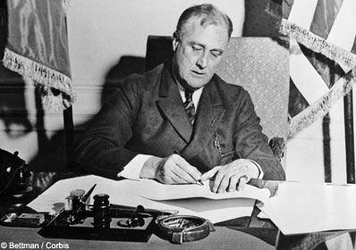 Securities+Act+of+1933 | FDR in 1933, signing the Emergency Banking Act to deal with the ...