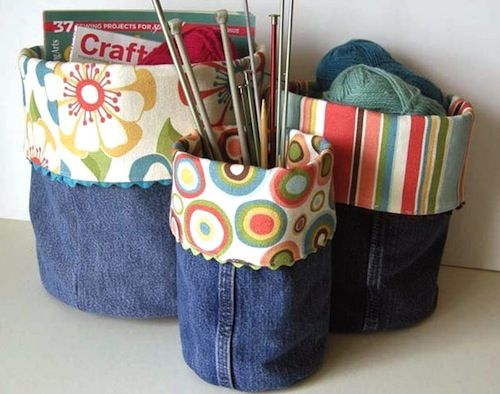 Blue jean pant legs recycled into storage containers and lined with patterned fabric in cool colors.