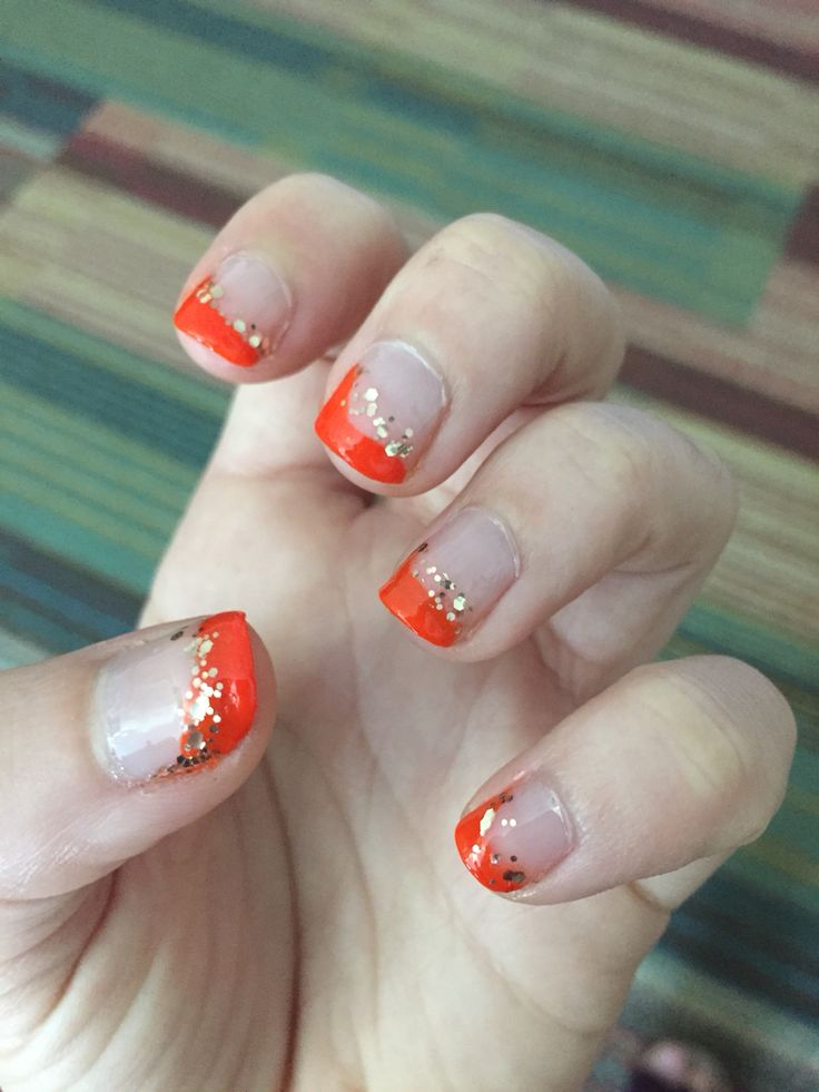 Sassy but classy orange nails.