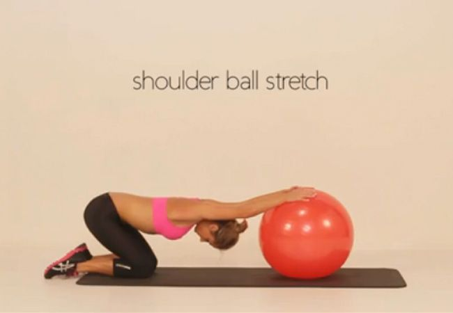 Stretch with medicine ball - workouts for a firmer bust - IMAGE - Women's Health & Fitness