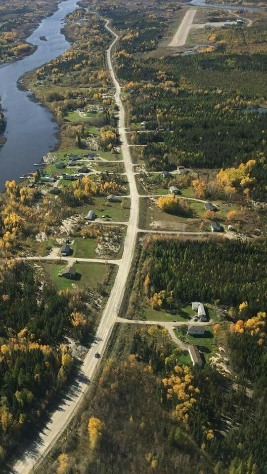 Jack River Road. You can see the airstrip in the foreground. In the middle is my Uncle's home as well as my two cousins.
