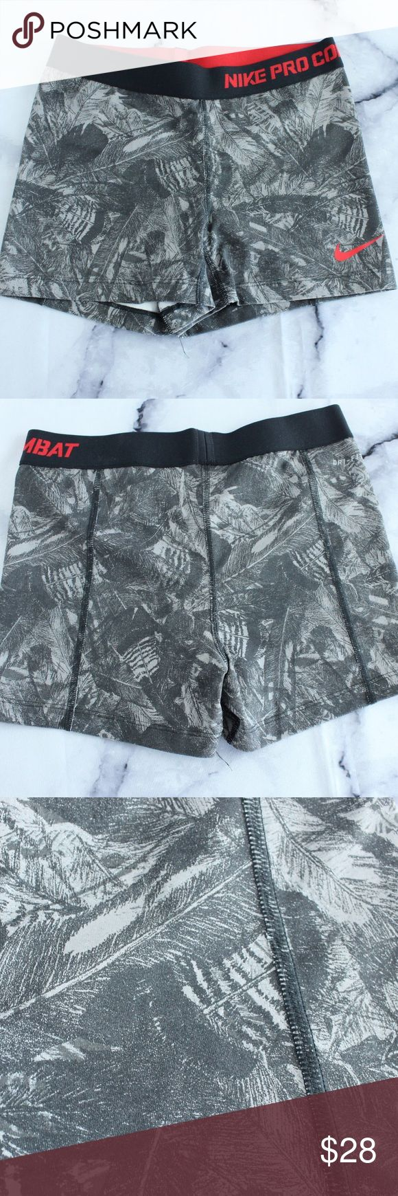 Nike Pro Combat Shorts Feather Print Red Band M CONDITION: used SIZE/FIT/STRETCH:   M on the tag. They are stretchy, but they fit true to size. FLAWS: No pilling, stains, or rips. Feel free to make an offer -OR- bundle your likes for me and I'll send you an offer with an exclusive discount! Nike Shorts