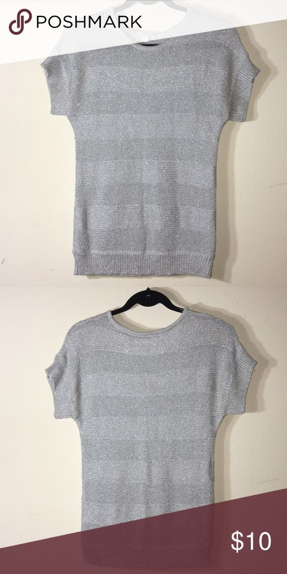 Metallic short sleeve top Made from 60% viscose, 26% polyester, 14% metallic. Make me an offer OR when you bundle 3 or more items from my closet you only pay shipping ONCE, you get 15% OFF, and a FREE JEWELRY RELATED GIFT!!! Tops