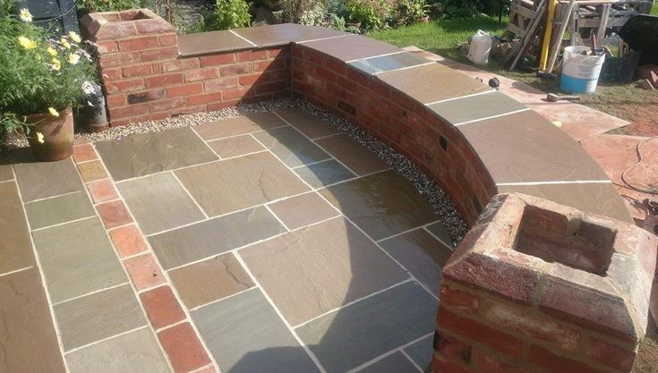 A quality cottage patio by Suffolk Landscaping and Masonry