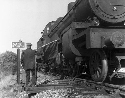Train passing over secured catchpoints, Shepton Mallet, Somerset, 1957.