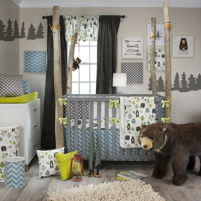 This outdoor forest and bear theme baby room is accented with a blue chevron print.