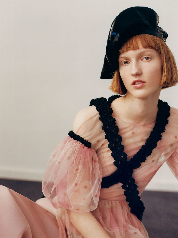 Ina wears dress, pants, and belts Simone Rocha. Beret House of Harlot.