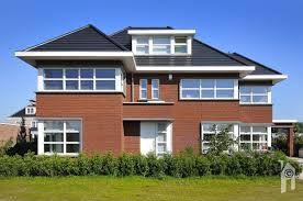 Afbeeldingsresultaat voor witte raamkozijnen rode bakstenen huis