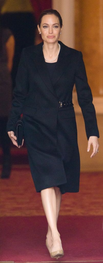 Angelina Jolie wearing a black cashmere coat with a leather belt closure on the side by Salvatore Ferragamo at the G8 Foreign Ministers Summit, held at Lancaster House on Thursday, April 11th in London. (Getty Images)2013