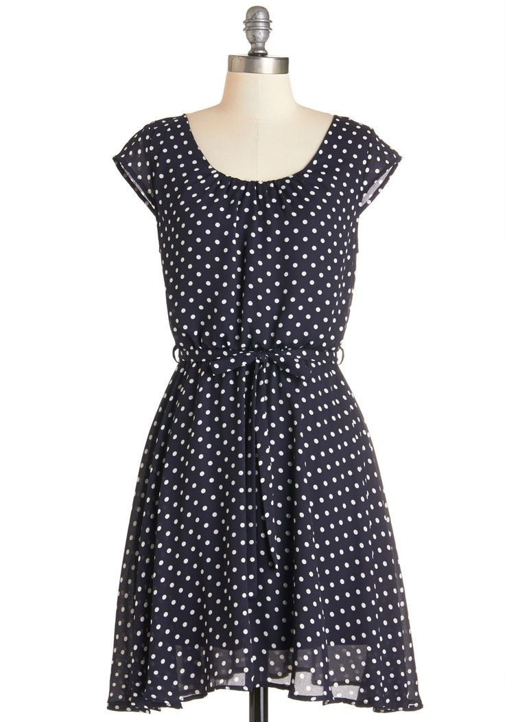 In the Winsome Circle Dress. Always up for a grandstand outing, youve donned this airy, polka-dotted dress for a Louisville road trip with friends! #blue #modcloth