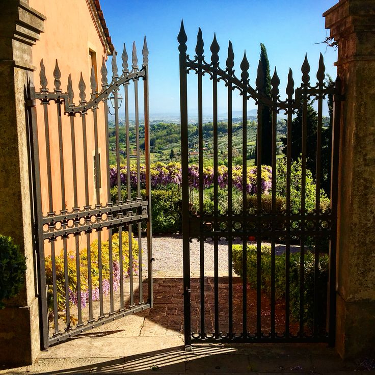 A gate over the rolling hills of Tuscany