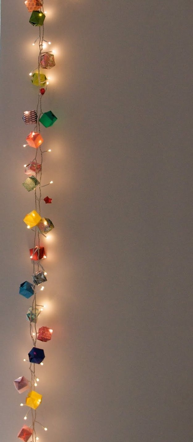 Instead of putting lights in the boxes, you could just intertwine them with an origami box garland.