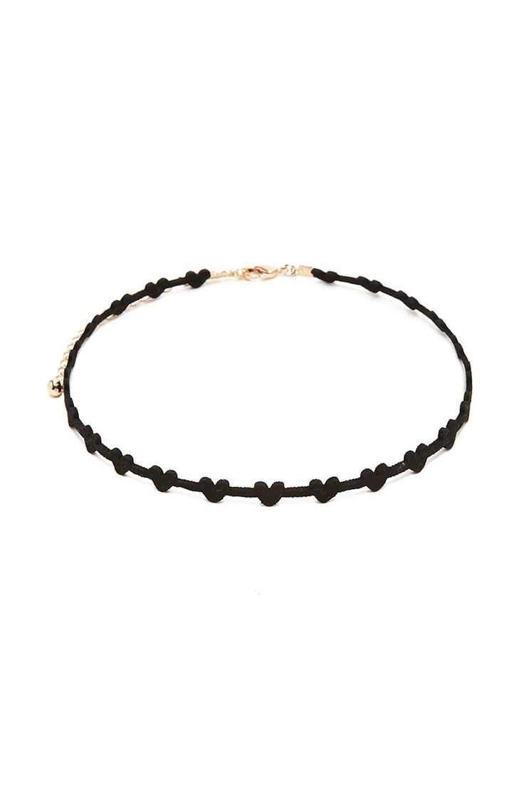 A faux suede choker featuring heart cutouts and a lobster clasp closure.