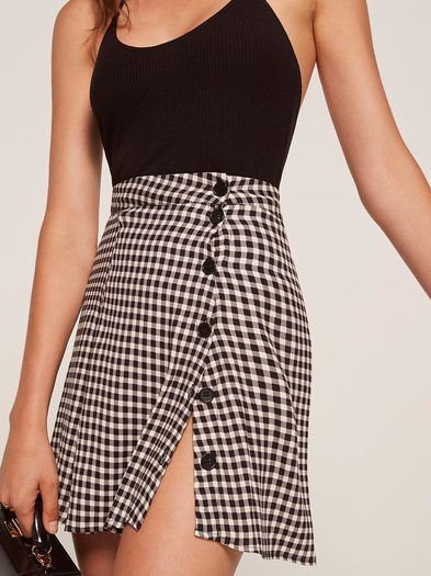 Let your legs say hello. This is a mini length, a-line skirt with buttons down the front.