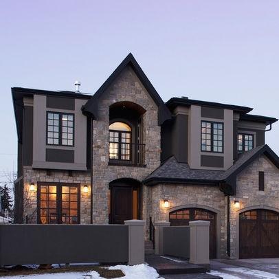 Dark Roof Windows With Light Exterior Stone Siding Combo