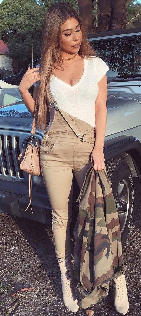 trendy outfit idea tee + jumpsuit + bag + khaki jacket