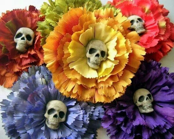 diy day of dead flowers.  cheap fake flowers with plastic skulls glued in center