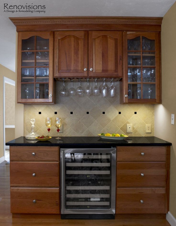 Kitchen remodel by Renovisions. Decorative tan and black ... on Backsplash Ideas For Black Granite Countertops And Cherry Cabinets  id=61451