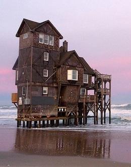 Wooden House On Stilts On The Beach
