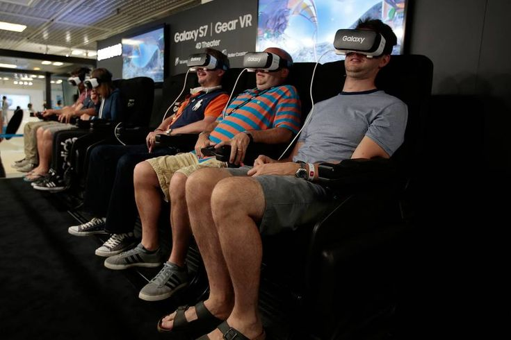 Visitors test a VR headset at the Cannes Lions advertising festival in Cannes, France.