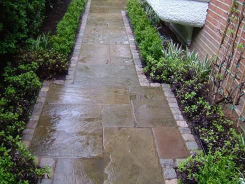 Reclaimed york stone paving and reclaimed granite setts are used to great effect on this path