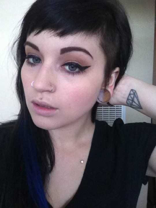 razored baby bangs and neutral