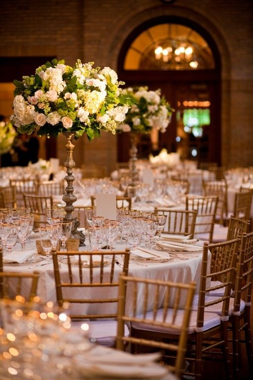 Formal wedding reception - those beautiful tall floral centerpieces are just timeless