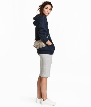 Light gray melange. Knee-length skirt in double-layer jersey with elasticized waistband.